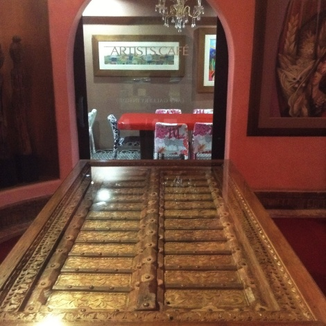 Always cool to see an antique door used as a table